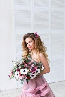 Fashion portrait. beautiful woman with bouquet.