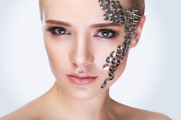 Fashion portrait of a beautiful woman with long eyelashes and piercing eyes.