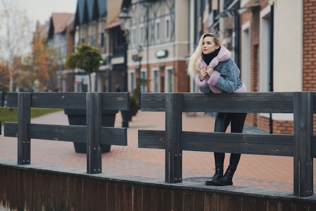 Fashion portrait of blonde girl in the city