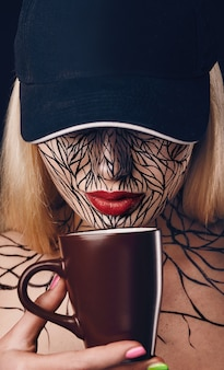 Fashion portrait of girl with faceart and red lips