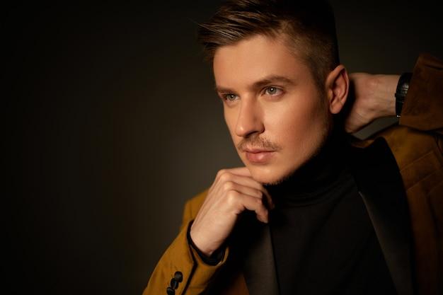 Fashion portrait of handsone sexy man in autumn suit