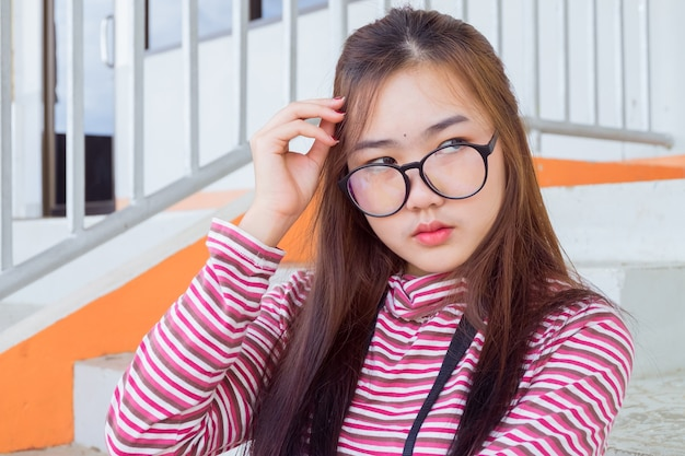 Fashion portrait of hipster teen girl wear casual warm clothes,posing on urban street.