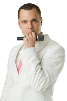 Fashion portrait - man singer with microphone isolated