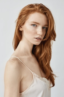Fashion portrait of natural redhead woman.
