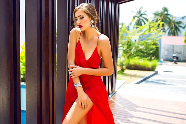 Fashion portrait of stunning elegant woman wearing luxury long silk dress