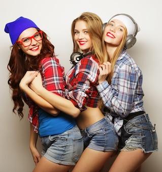 Fashion portrait of three stylish hipster girls best friends