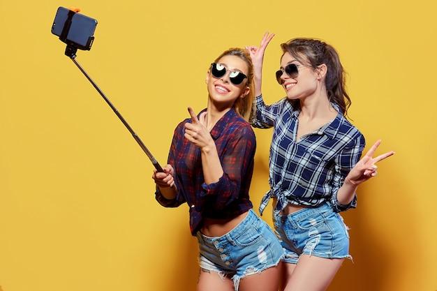 Fashion portrait of two friends posing.
