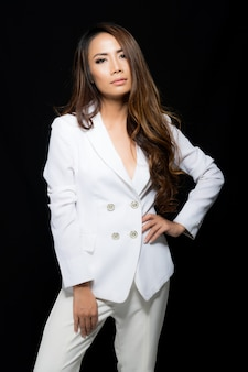 Fashion portrait woman wearing a white suit.