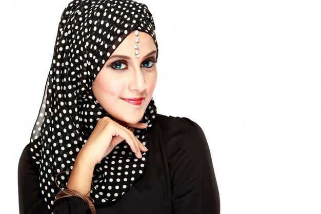 Fashion portrait of young beautiful muslim woman with black scarf