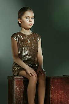 The fashion portrait of young beautiful preteen girl at studio