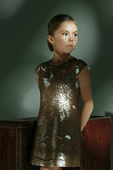 The fashion portrait of young beautiful teen girl at studio