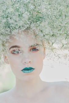 Fashion portrait of young blond woman, beautiful woman with green lips. concept of mother nature