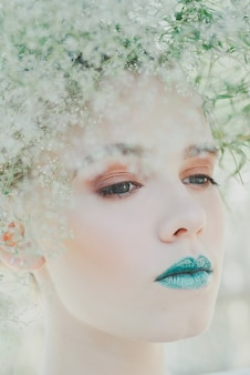 Fashion portrait of young blond woman. beautiful woman with green lips. concept of mother nature