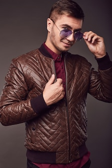 Fashion portrait of young handsome man with aviator glasses