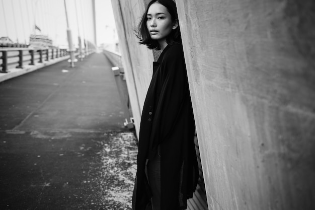 Fashion shoot of an asian woman in the city