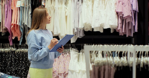 Fashion shop sales retail manager checks stock. small business owner orders merchandise.