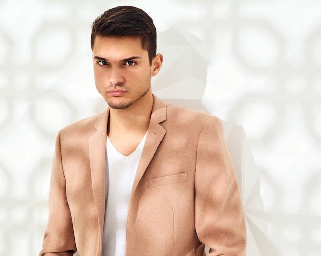 Fashion stylish  model dressed in elegant light pink suit