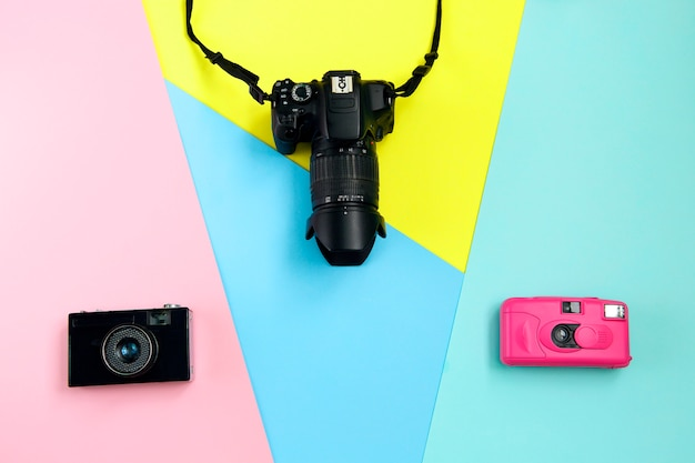 Fashion three cameras on yellow, blue and pink background