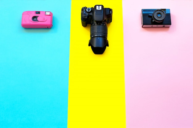 Fashion three cameras on yellow, blue and pink.