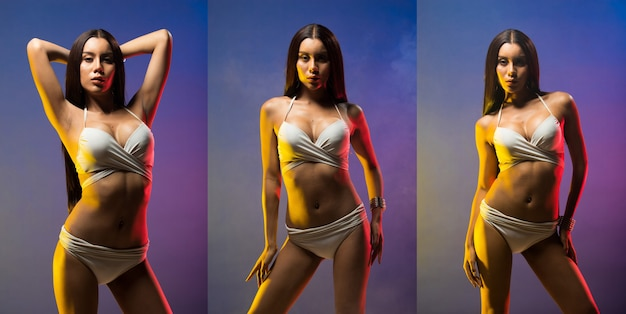 Fashion transgender asian woman tan skin long black hair beautiful high fashion make up accessories wear white bikini. studio lighting blue purple smoke background copy space text logo