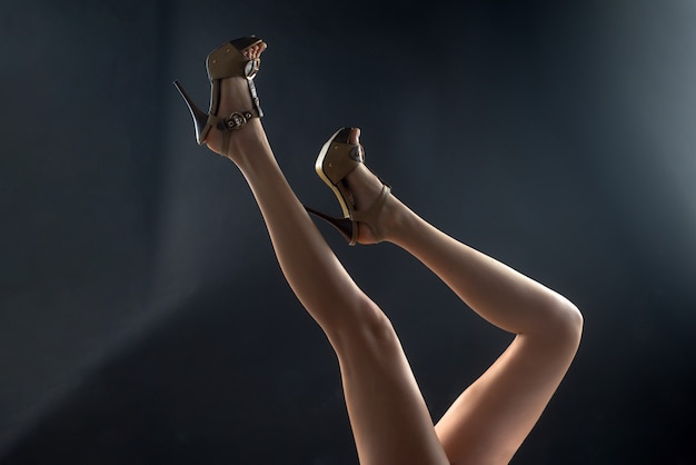 Fashion trendy shoes. sexy woman slim legs in heels.
