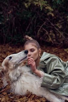Fashion type photo of a stylish woman with a dog