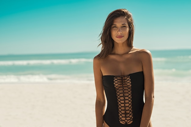 Fashion woman in black swimsuit