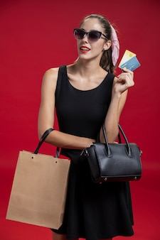 Fashion woman holding her credit cards