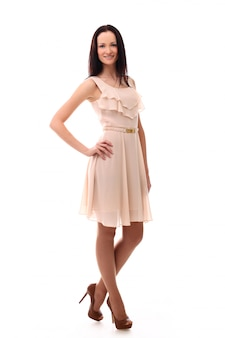 Fashion woman posing with dress in pastel pink color, isolated