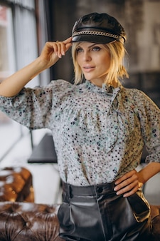 Fashion woman standing in a cafe