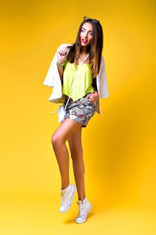 Fashion woman wearing neon bright color block clothes, casual vintage spring style