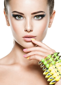 Fashion woman with beautiful nails and jewelry