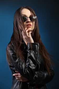 Fashion woman with long hair wearing leather jacket