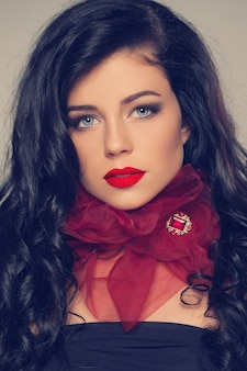 Fashion woman with red brooch