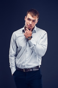 Fashion young businessman on dark background