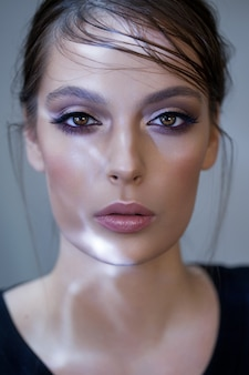 Fashion young model with lilac and grey professional makeup, wet hairstyle, perfect skin
