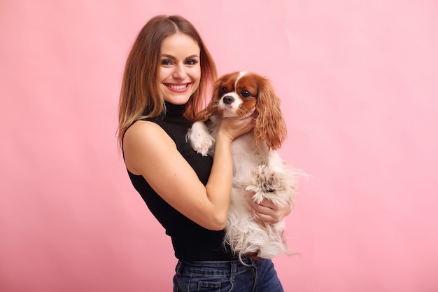 Fashion young woman posing with dog