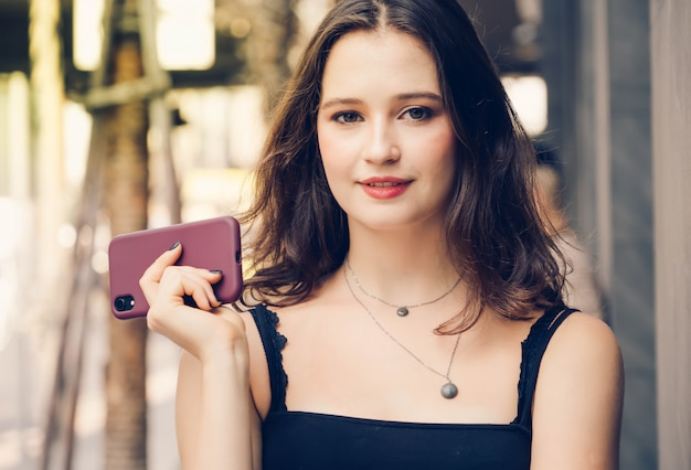 Fashion young woman posing with smartphone
