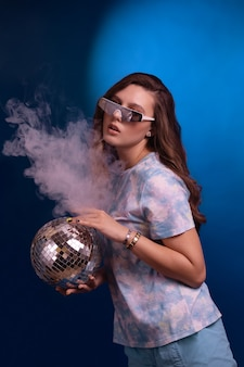 Fashion young woman with disco ball