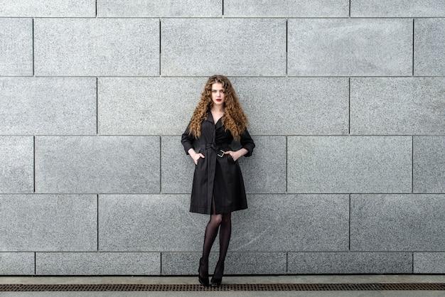 Fashionable beautiful brunette girl in a modern city