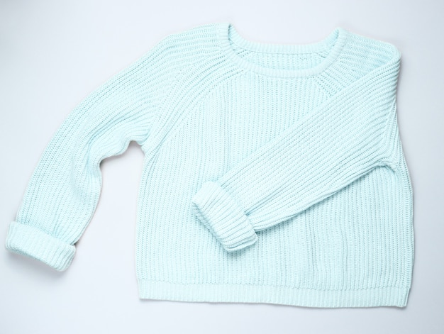 Fashionable blue pastel knitted sweater isolated