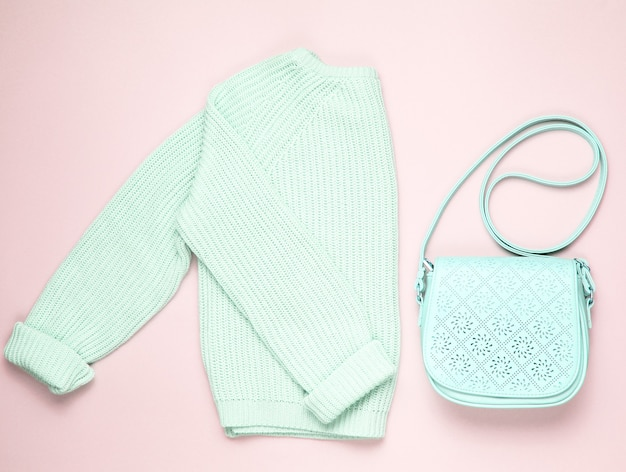 Fashionable blue pastel knitted sweater leather bag isolated