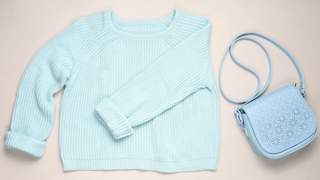 Fashionable blue pastel knitted sweater leather isolated