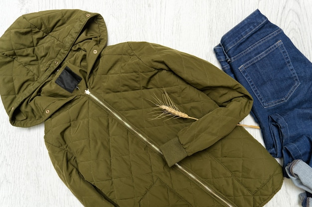 Fashionable concept. khaki  jacket with hood and blue jeans