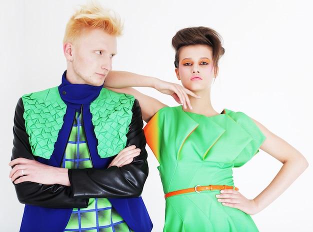 Fashionable couple posing at studio