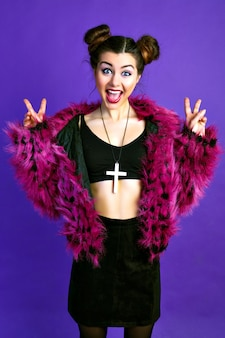 Fashionable crazy portrait of cheerful funny brunette woman, posing in trendy grudge outfit, faux fur jacket