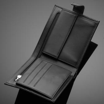 Fashionable designer leather men's wallet on a black background