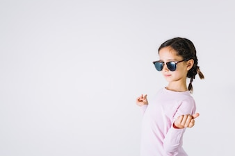 Fashionable girl snapping fingers