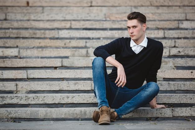 Fashionable handsome man model posing
