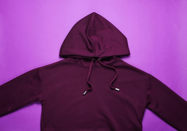 Fashionable hoody on a purple table. top view
